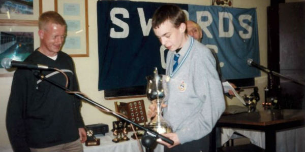 Photo of me aged 16, collecting my student achievement award in the CBS